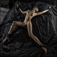 Natali tied on bed