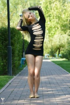Sexy blonde teen in a very sexy dress