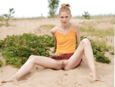 Young teen spreading her legs