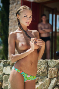 Beautiful blonde babe topless at the beach