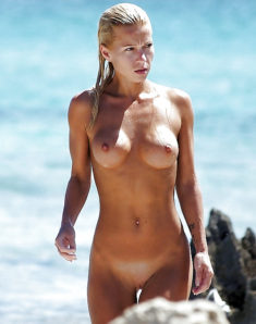 Young beauty nudist with a perfect body