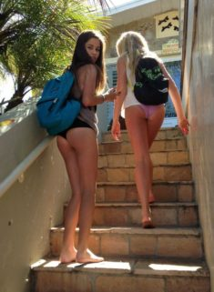 Young teens walking on the street with sexy shorts