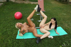 Kristy Black and Lola share a big toy outdoors