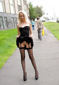 Young slim blonde flashing in the street
