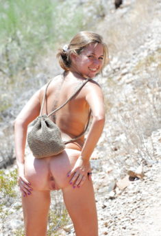 Young nudist backpacker spreads her ass