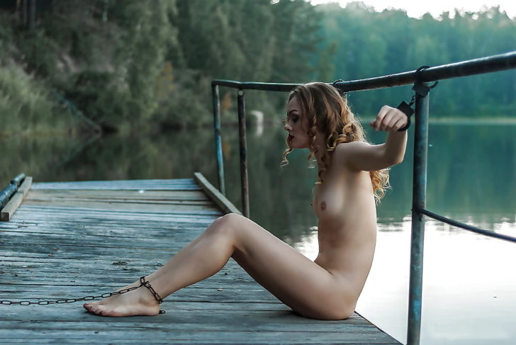 Young beauty tied on a dock