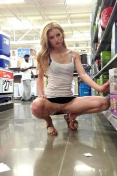Young beauty flashing her pussy in a store