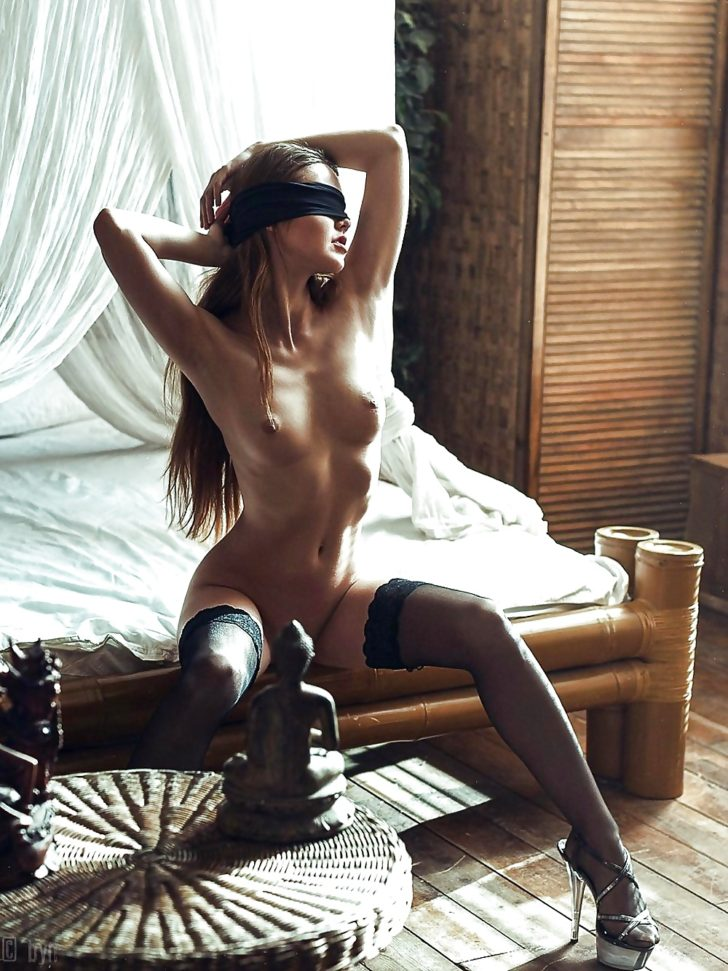 Blindfolded beauty in lingerie