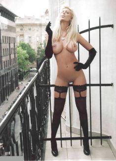 Perfect babe smoking nude on her balcony