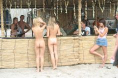 Young nudist teen at the beach bar