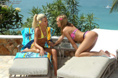 Young lesbian teens Kacey Jordan and Blue Angel at the beach pool