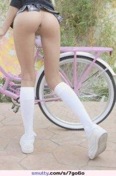 Young schoolgirl bottomless in bike