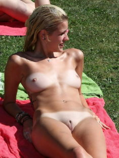 Young nudist blonde with a perfect tight body and shaved pussy