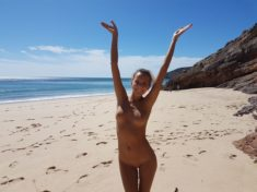 Katya Clover chilling nude on a beach