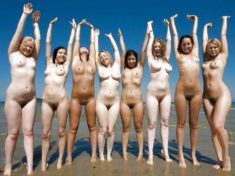 Group of nudist babes on the beach