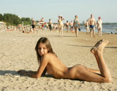 Sexy young nudist teen on a public beach