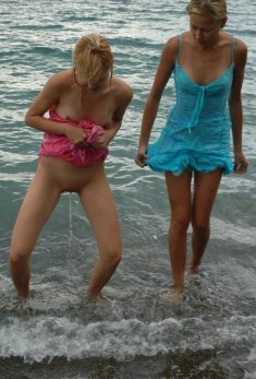 Slutty teen peeing in public in the sea