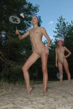 Young nudist teens playing badminton