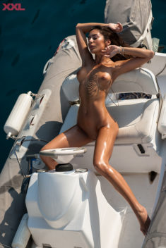 Oiled nudist babe on a boat