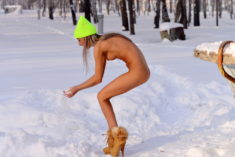 Skinny nude model in high heels in the snow