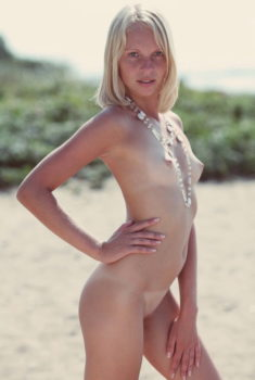 Young nudist blonde beauty