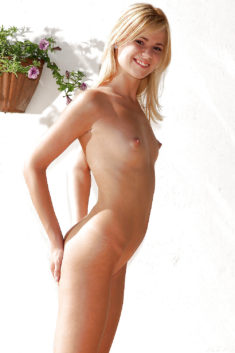 Young blonde beauty with perfect tiny tits