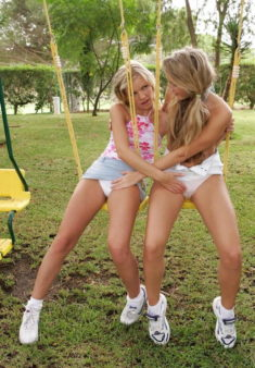 Young schoolgirl lesbians touching each other