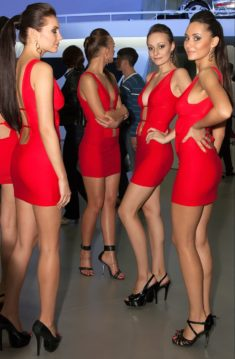 Sexy model in red mini dress and high heels