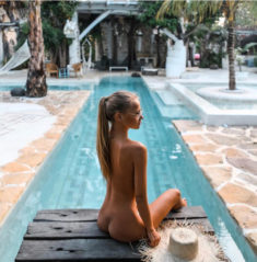 Young beauty nude by the pool