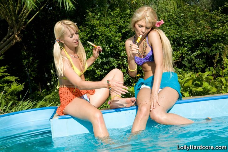 Young slutty teen Lolly Hardcore in lesbian action