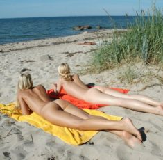 Young nudist teens on the beach