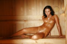 Young perfect beauty oiled in the sauna