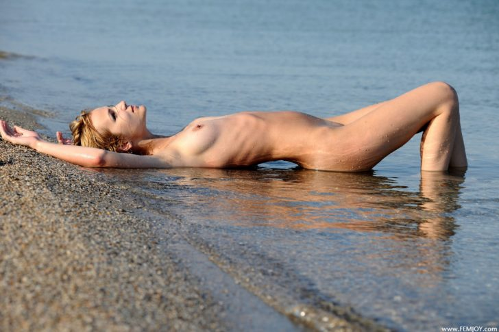 Young beauty nude at the beach