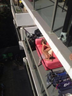 Young exhibitionist on her balcony