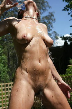 Mature slut showering outdoors