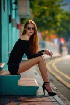 Perfect sexy redhead babe in high heels