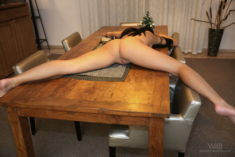 Brunette model offered legs open on a table