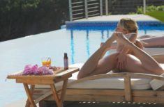 Perfect oiled Leila by the pool
