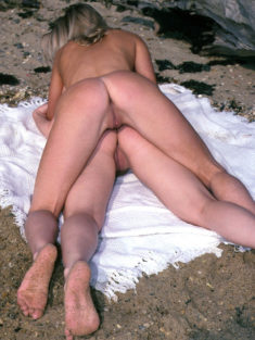 Young blonde lesbian beauties on the beach