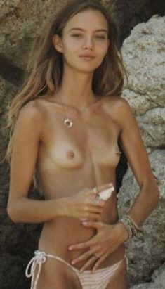 Perfect topless beauty at the beach