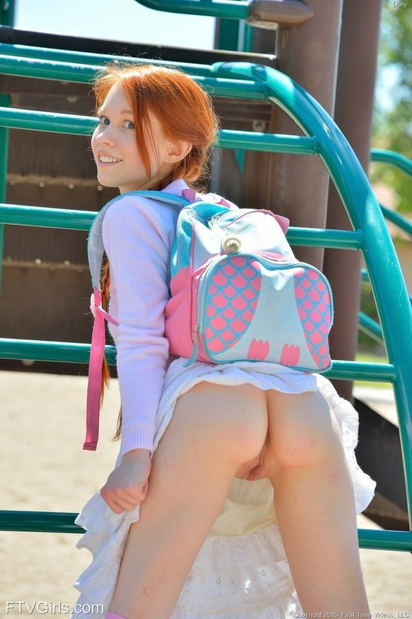 Young redhead schoolgirl Dolly flashing her beautiful small ass