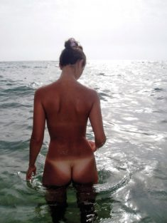 Young nudist in the sea