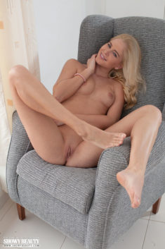 Young blonde beauty with a smooth pussy