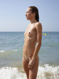 Young nudist beauty with a perfect tight body