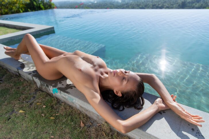 Katya Clover sunbathing by the pool with her perfect body