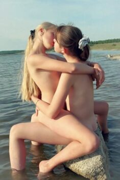 Young nudist lesbians kissing