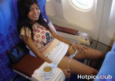 Young Thai teen flashing her shaved pussy in a plane