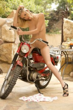Sexy babe nude on a motorbike