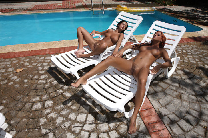 Tanned babes by the pool