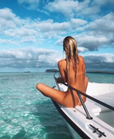 Nudist beauty babe on a boat